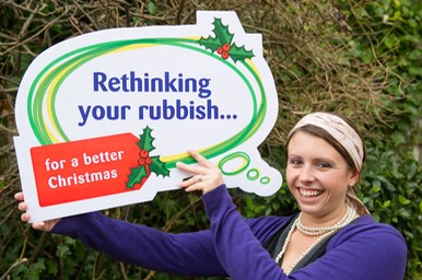 Suzanne holding rethinking your rubbish sign